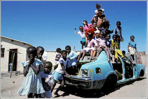 Children playing on an abandoned car, Luderitz